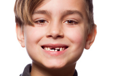 stock-photo-87593289-boy-portrait-with-a-lost-tooth